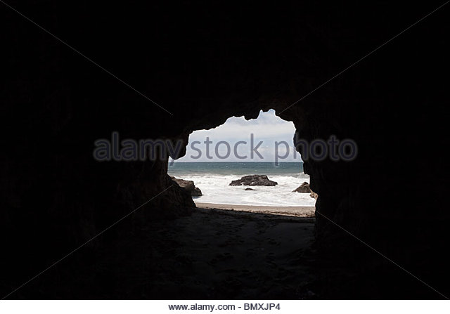 View through cave hole toward sea - Stock Image