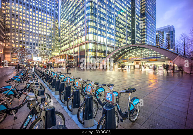 Canary Wharf tube station and Boris bikes. - Stock Image
