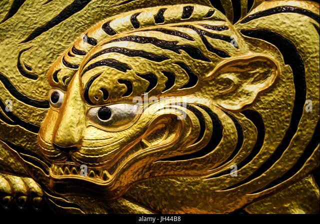 Golden crouching tiger panel in Osaka Castle. Osaka, Japan. Also called Hunting Tiger. - Stock Image