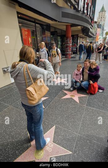 Tourists at Walk of Fame at Hollywood Boulevard, Hollywood, California, USA - Stock Image