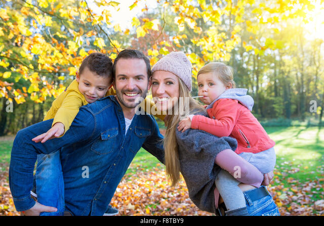 Portrait of a family in park - Stock-Bilder