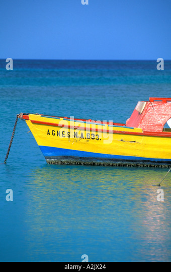 ARUBA Colorful Fishing Boat in bright water - Stock Image