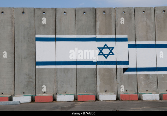 The Israeli flag painted over precast concrete wall panels at the Kerem Shalom border crossing with Gaza strip Southern - Stock Image