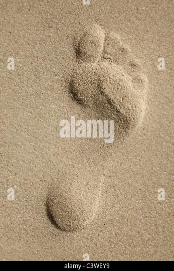 Singel footprint on sand beach - Stock Image