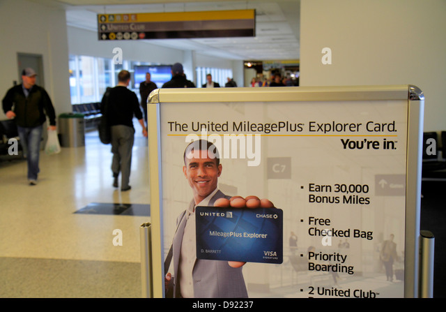 Texas Houston George Bush Intercontinental Airport IAH concourse gate area promotion credit card United MileagePlus - Stock Image