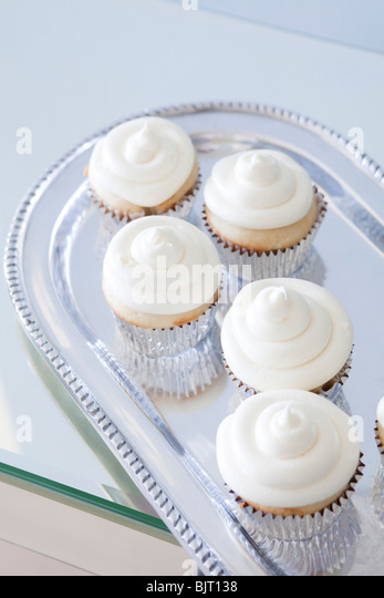 USA, California, San Francisco, cupcakes with frosting on silver plate - Stock Image