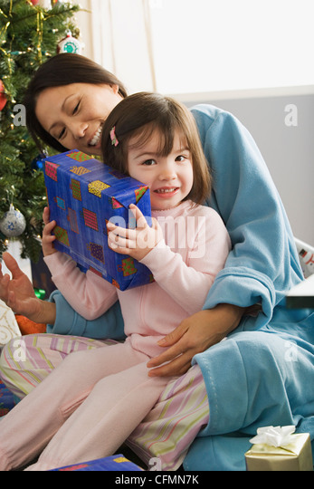 USA, California, Los Angeles, Mother and daughter (10-11) at Christmas morning - Stock Image