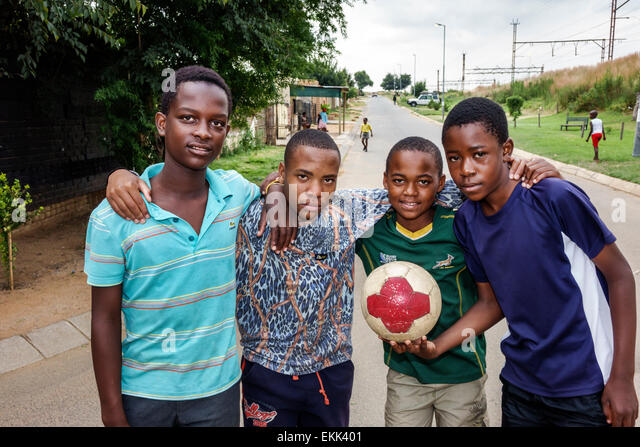 Johannesburg South Africa African Soweto Black boy friends soccer football ball teen - Stock Image