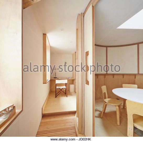 View of upstairs oval meeting room and drawing desk,. Studio Totnes, Totnes, United Kingdom. Architect: David Sheppard - Stock-Bilder