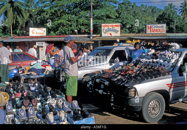 Dominican Republic Samana Peninsula Santa Barbara de Samaná  market selling shoes - Stock Image