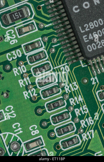 Macro-photo of printed circuit components on a PC motherboard. - Stock Image