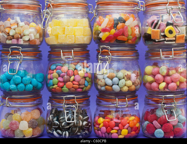 Colourful assorted childrens sweets and candy in jars - Stock Image