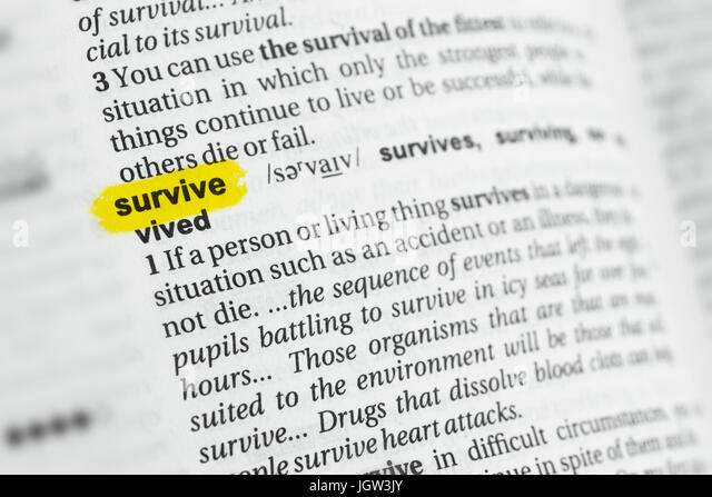 Highlighted English word 'survive' and its definition at the dictionary. - Stock Image