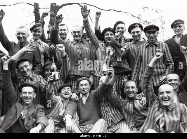 DACHAU Prisoners celebrate the liberation of the Nazi concentration camp near Munich in April 1945 - Stock Image