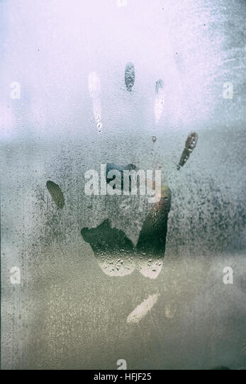 Hand print in a window - Stock Image