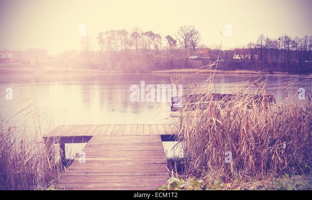 Vintage retro toned image of lake in autumn. - Stock Image