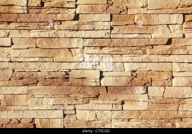 wall of the house lined with stone - Stock-Bilder