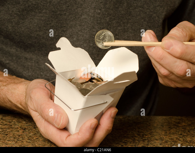man holding Chinese food container containing US currency - Stock-Bilder