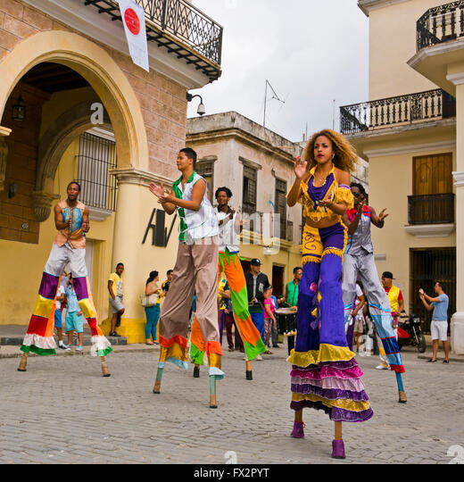 Square portrait of stilt walkers performing in Havana, Cuba. - Stock Image