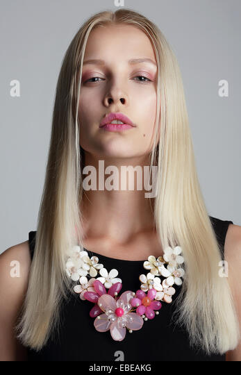 Long Hair Blonde with Vernal Garland on her Neck - Stock Image
