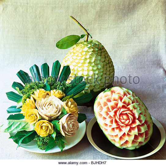 Artistically carved exotic fruit (Asia) - Stock-Bilder