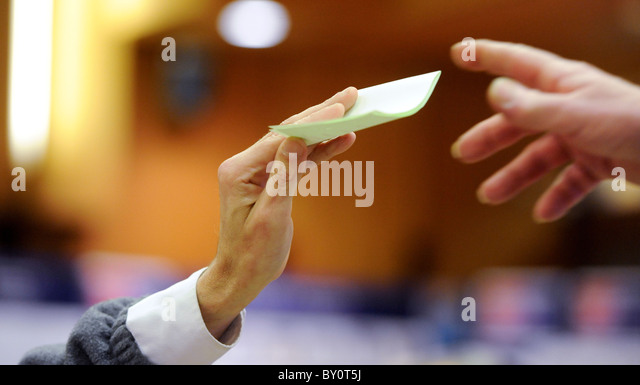 A ballot slip being being collected. - Stock Image
