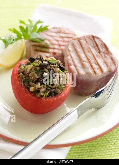 Stuffed tomato griddled tuna - Stock Image