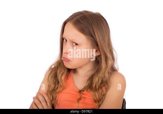 Angry child make a grimace. Isolated on a white background. - Stock Image
