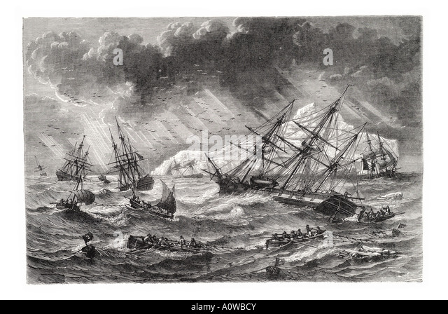 coast Iceland sailing ship sail squall sea storm rowing boat wave cliff shore surf ocean Atlantic rain weather mast - Stock Image