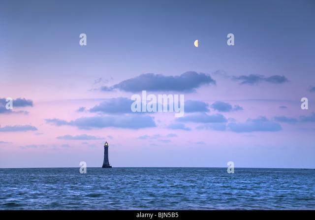 Half moon above Haulbowline lighthouse, Carlingford Lough. Northern Ireland. - Stock-Bilder