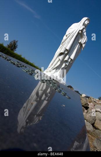 Maria Statue on graveyard monument in Workum, Fryslan, The Netherlands - Stock Image