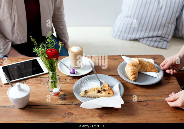 Having coffee and croissant - Stock Image