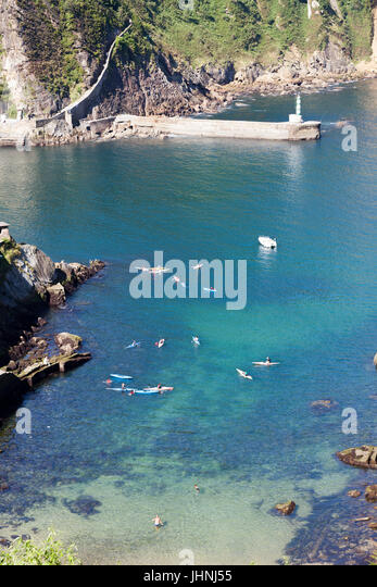 At Pasajes (Spain), a flock of teenagers practising canoeing in the eponymous fjord.  Pasajes is the San Sebastian's - Stock Image