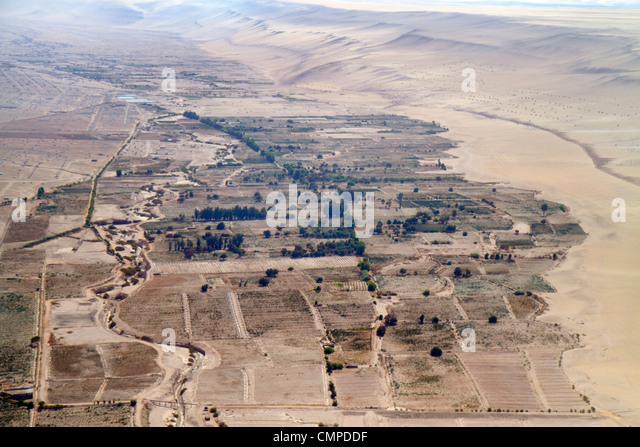 Peru Tacna LAN flight from Lima aerial window view mild desert climate land grid topography - Stock Image