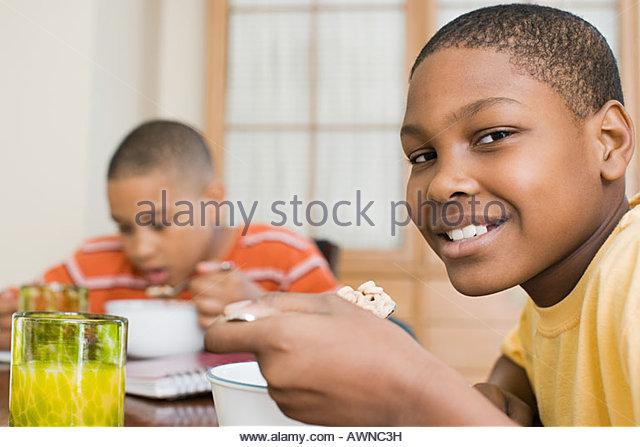 Boys having breakfast - Stock Image