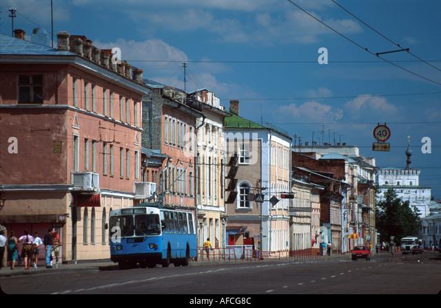 Russia former Soviet Union Yaroslavl city street residents traffic public transportation - Stock Image