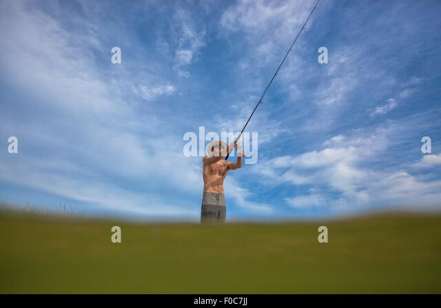 Watery view of mature man fishing, Fort Walton, Florida, USA - Stock Image