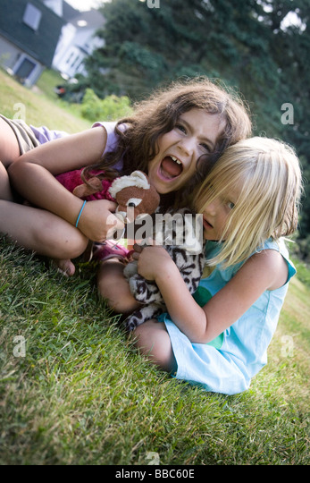 Girls playing in backyard - Stock Image