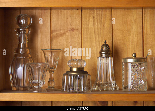 Antique glass on a wooden shelf - Stock-Bilder