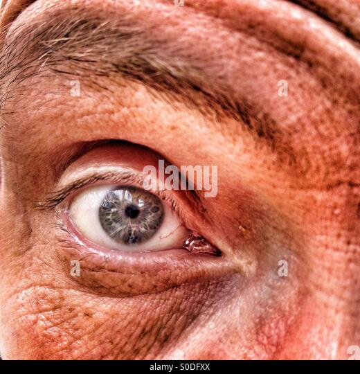 Close up of adult males eye - Stock Image