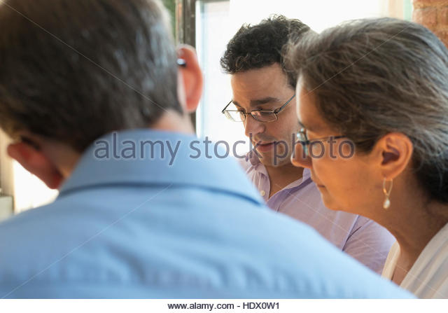 Business people in meeting - Stock Image