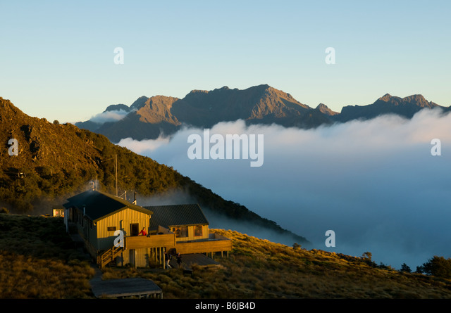 Sunrise at the Mount Luxmore Hut, Kepler Track, South Island, New Zealand - Stock Image