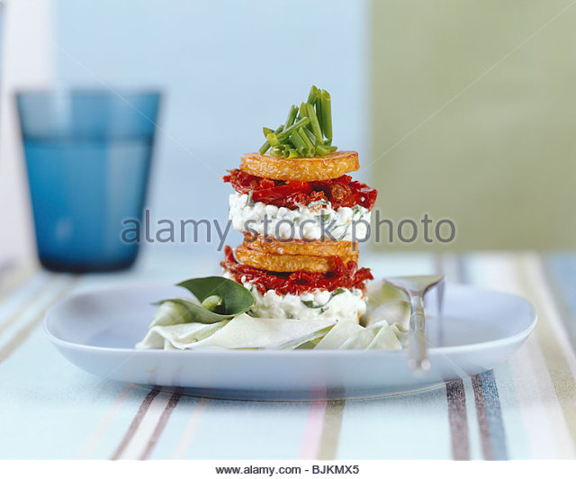 Tower of fried potatoes & cottage cheese with ramsons - Stock Image