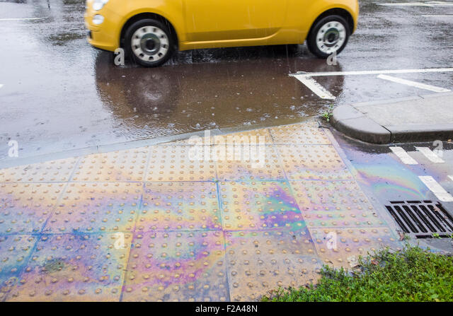 Billingham, UK. 15th September, 2015. Weather: Fuel spill as drain overflows during heavy early morning rain on - Stock Image