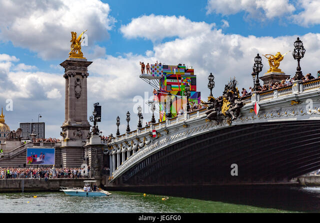 Paris, France. 24th Jun, 2017. Diving athlete demonstrating over the Seine river during the Paris Olympic Games - Stock Image