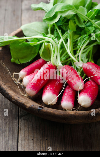 Fresh radishes on a wooden board - Stock Image