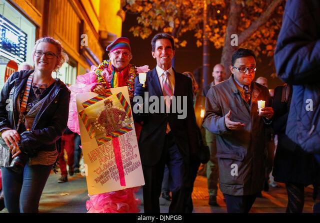 San Francisco, California, USA. 27th Nov, 2013. BRUCE BEAUDETTE walks alongside California State Senator MARK LENO - Stock Image