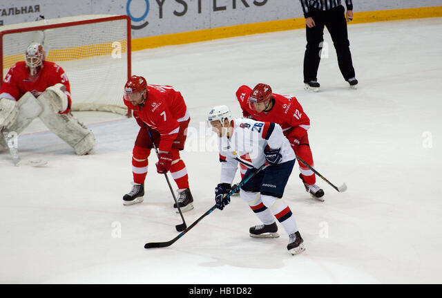 MOSCOW, RUSSIA - NOVEMBER 26, 2016: D. Kalinin (7) and I. Musatov (26) wait a faceoff on hockey game Spartak vs - Stock Image