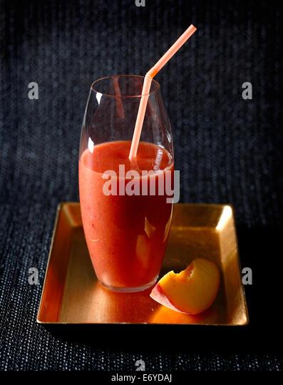 Peach,banana and strawberry juice - Stock Image