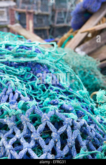Fishing industry nets pots and equipment at Torquay harbour Devon - Stock Image